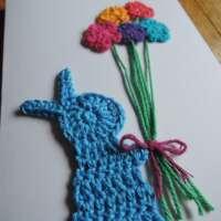 Blue Crochet Bunny Holding Flowers thumbnail